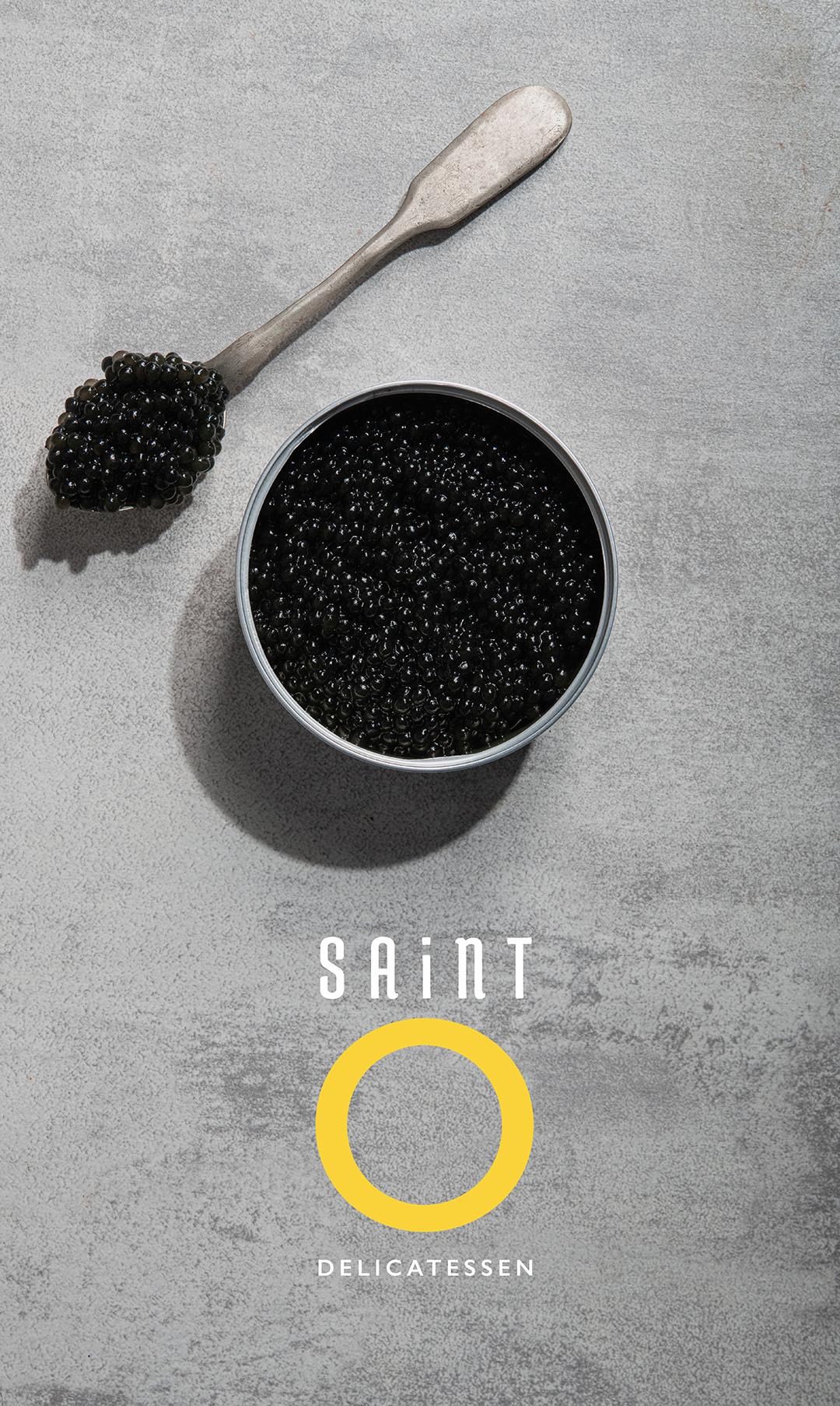 Saint O Delicatessen logo superimposed onto an image of black caviar